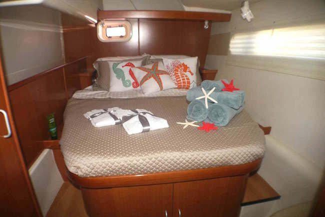 Image of a bedroom aboard the Starfish - USVI Catamaran Charter Special