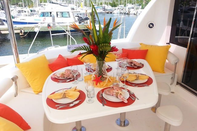 Photo of a set table for 6 on the USVI Catamaran Charter Starfish