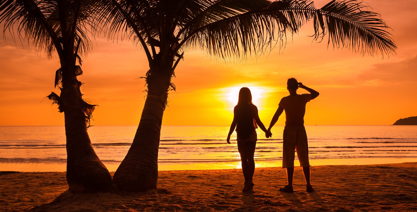 Honeymoon Couple on a Typical Beach on a Caribbean Honeymoon Private Yacht Charter