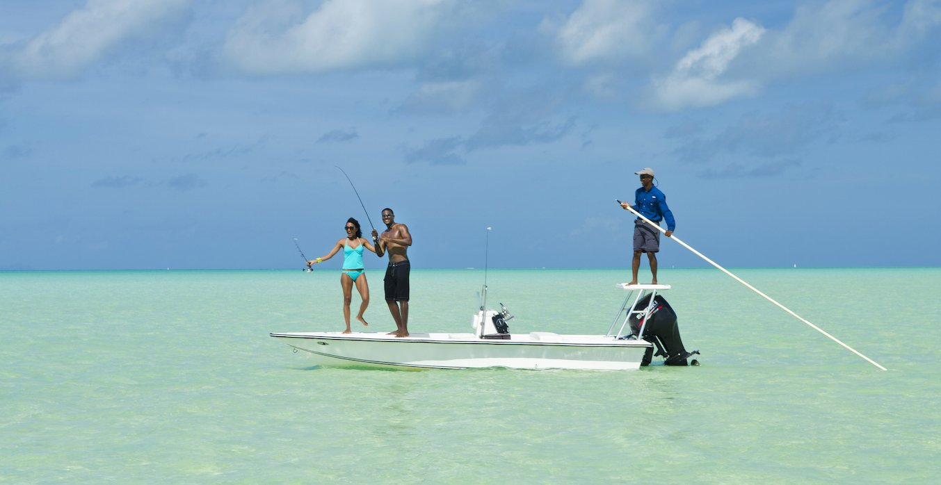 Couple bonefishing in the Anegada reef with a fishing guide.