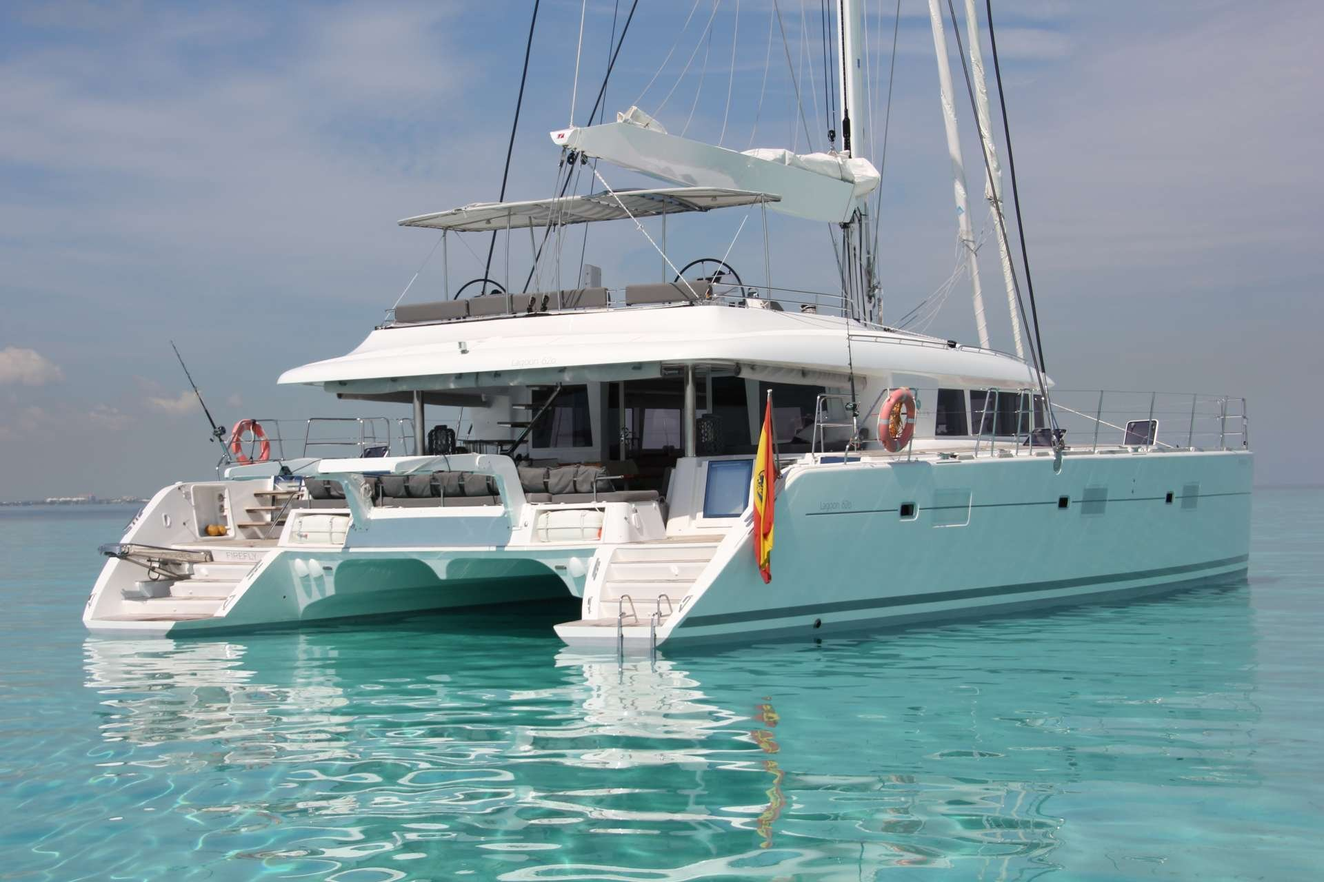 Catamaran Yacht 'FIREFLY' At anchorage, 6 PAX, 3 Crew, 61.00 Ft, 18.00 Meters, Built 2011, Lagoon