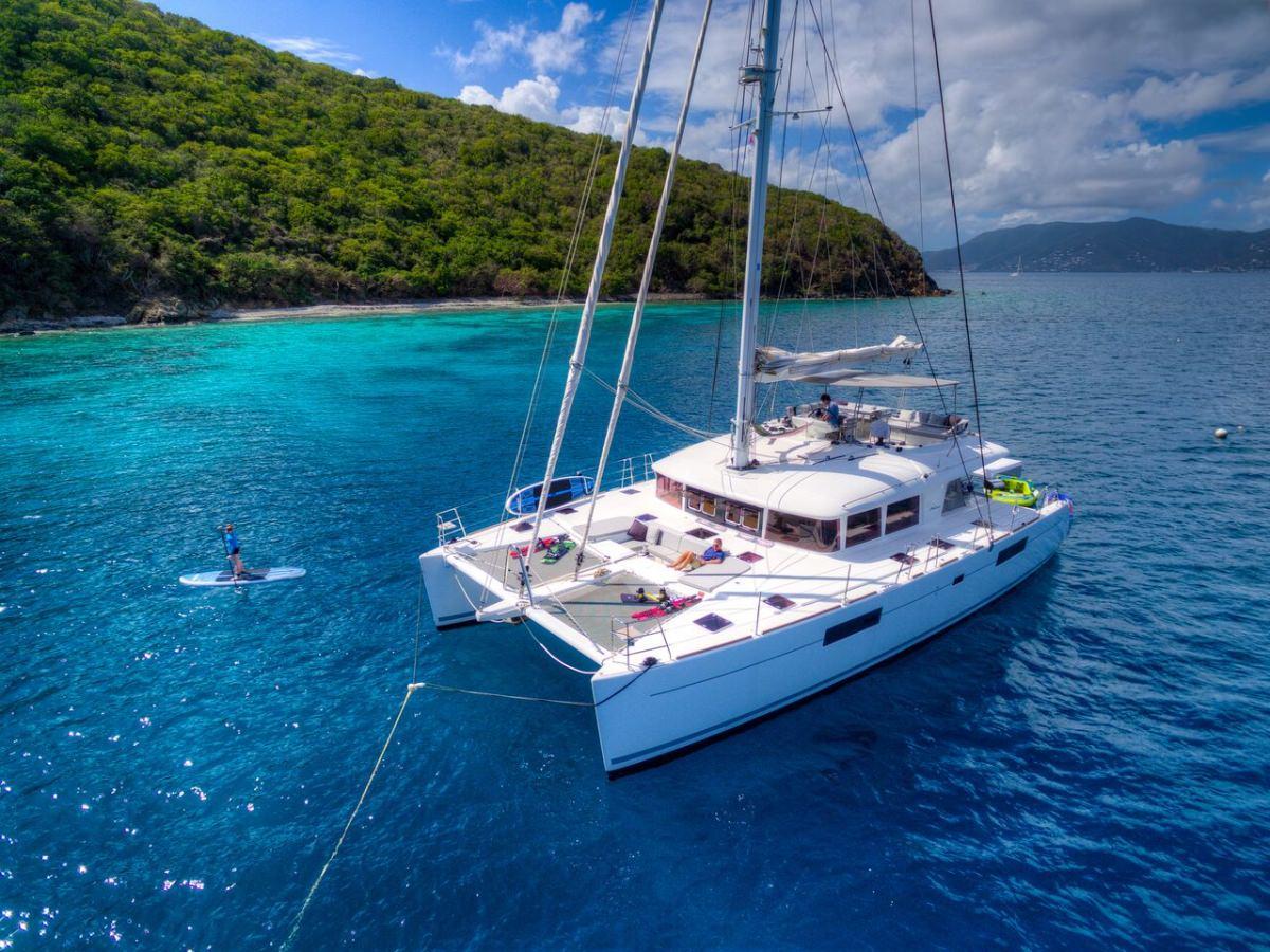 Catamaran Yacht 'ALTESSE' Paddleboard in the water, 8 PAX, 2 Crew, 56.00 Ft, 17.00 Meters, Built 2013, Lagoon, Refit Year 2019