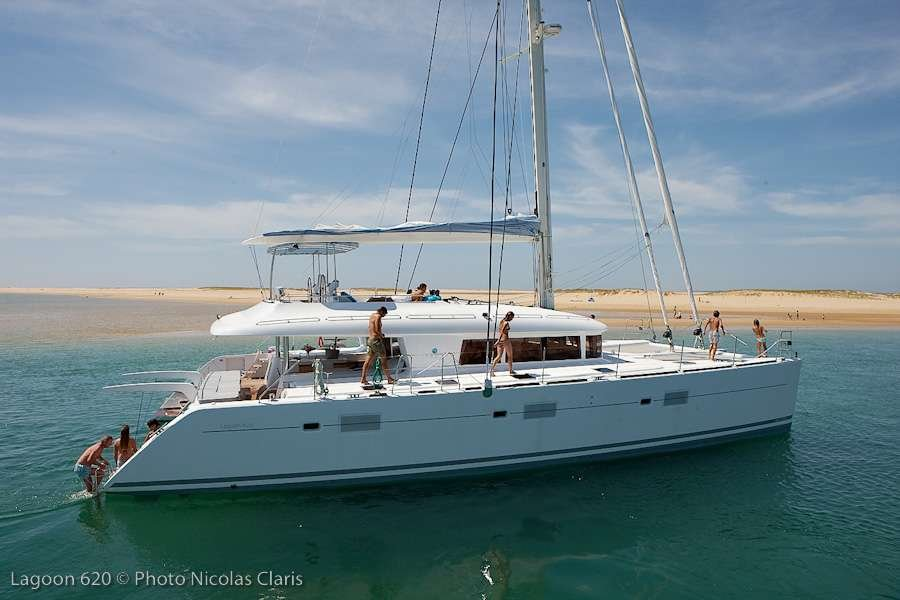 Catamaran Yacht 'FIREFLY' At anchorage (sistership), 6 PAX, 3 Crew, 61.00 Ft, 18.00 Meters, Built 2011, Lagoon