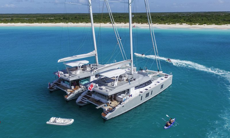 Tandem Catamaran Charter Anchored in Barbuda