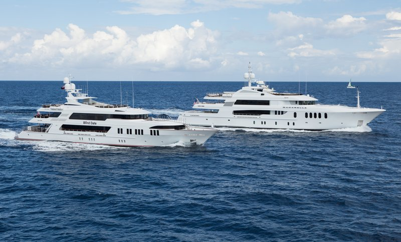 Two super yachts cruising in tandem