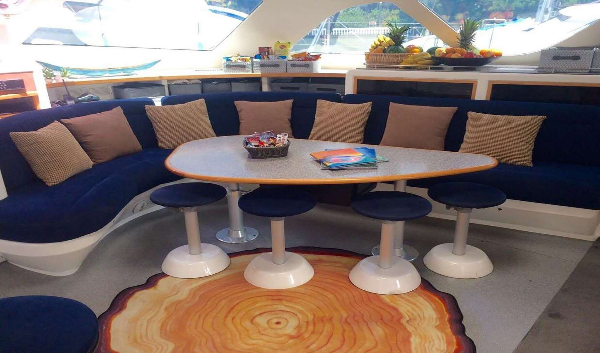 Catamaran Yacht 'YES DEAR' Salon seating area, 10 PAX, 2 Crew, 58.00 Ft, 17.00 Meters, Built 2007, VOYAGE yacht, Refit Year 2012