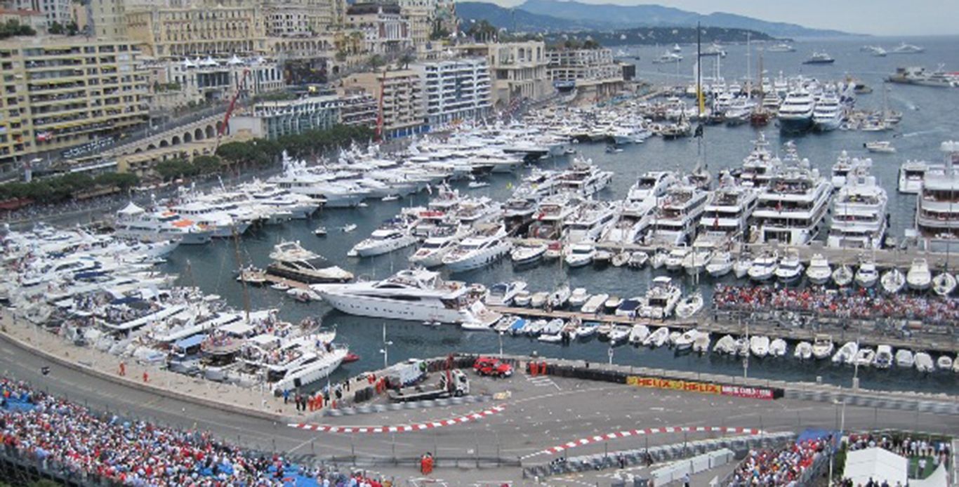 Arial view of the Monaco Grand Prix race track with super Yacht Charters anchored in the harbor.