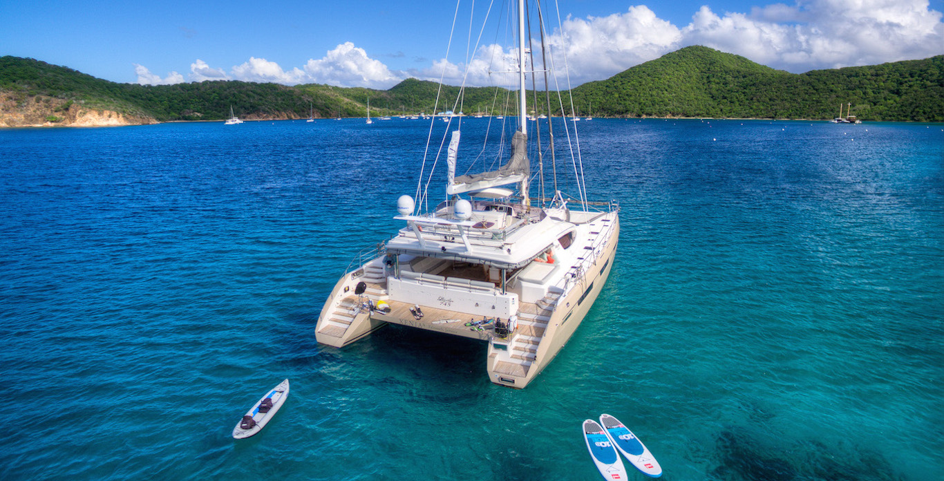 Photo of a Catamaran Yacht charter anchored in a harbor somewhere in the Caribbean