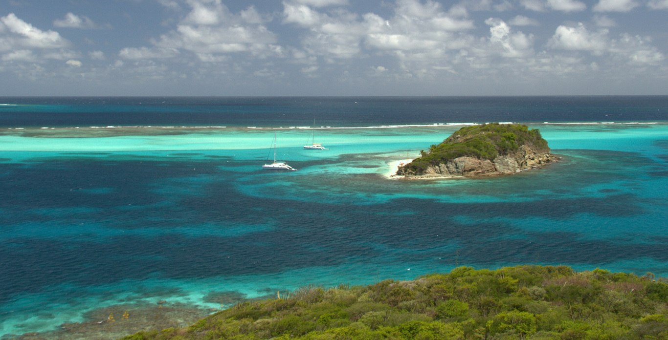 Image of the coast of the Grenadines on a Catamaran Charter