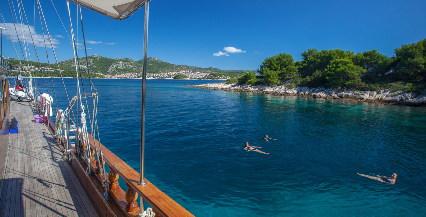 Relaxing in the waters at the side of the Stella Mari,s a 124.6' that accommodates 16 guests
