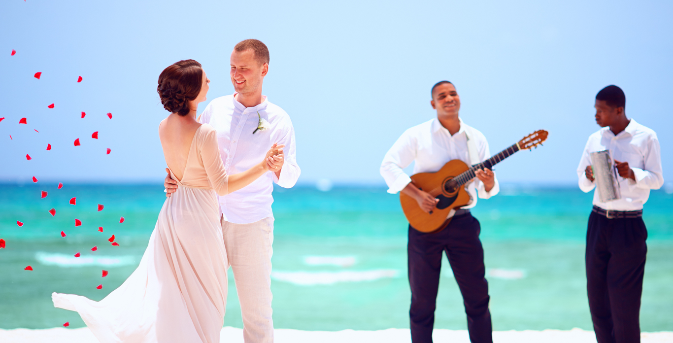 Newly weds dancing on the Mediterranean beach - Wedding Yacht Charters